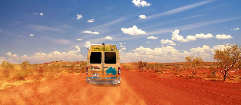 Wheelie Campers campervan driving on the red dirt roads of the Outback