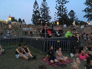 Two wheelchair users enjoying Falls Festival on an accessible platform